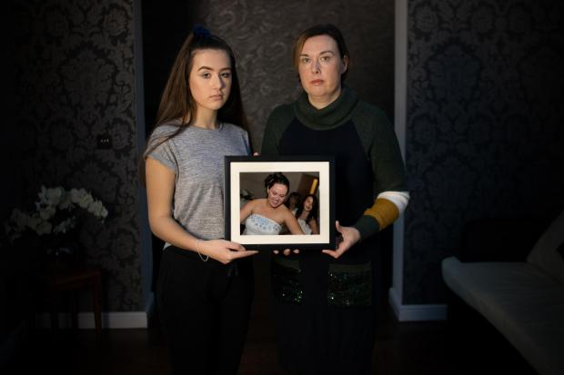 Bicester Advertiser: Tonight's documentary will also explore the story of Kirstie, pictured with her auntie, Jo. They are holding a photograph of Kirstie's mum, Natalie, who was murdered by an abusive partner. Picture: Behind Closed Doors