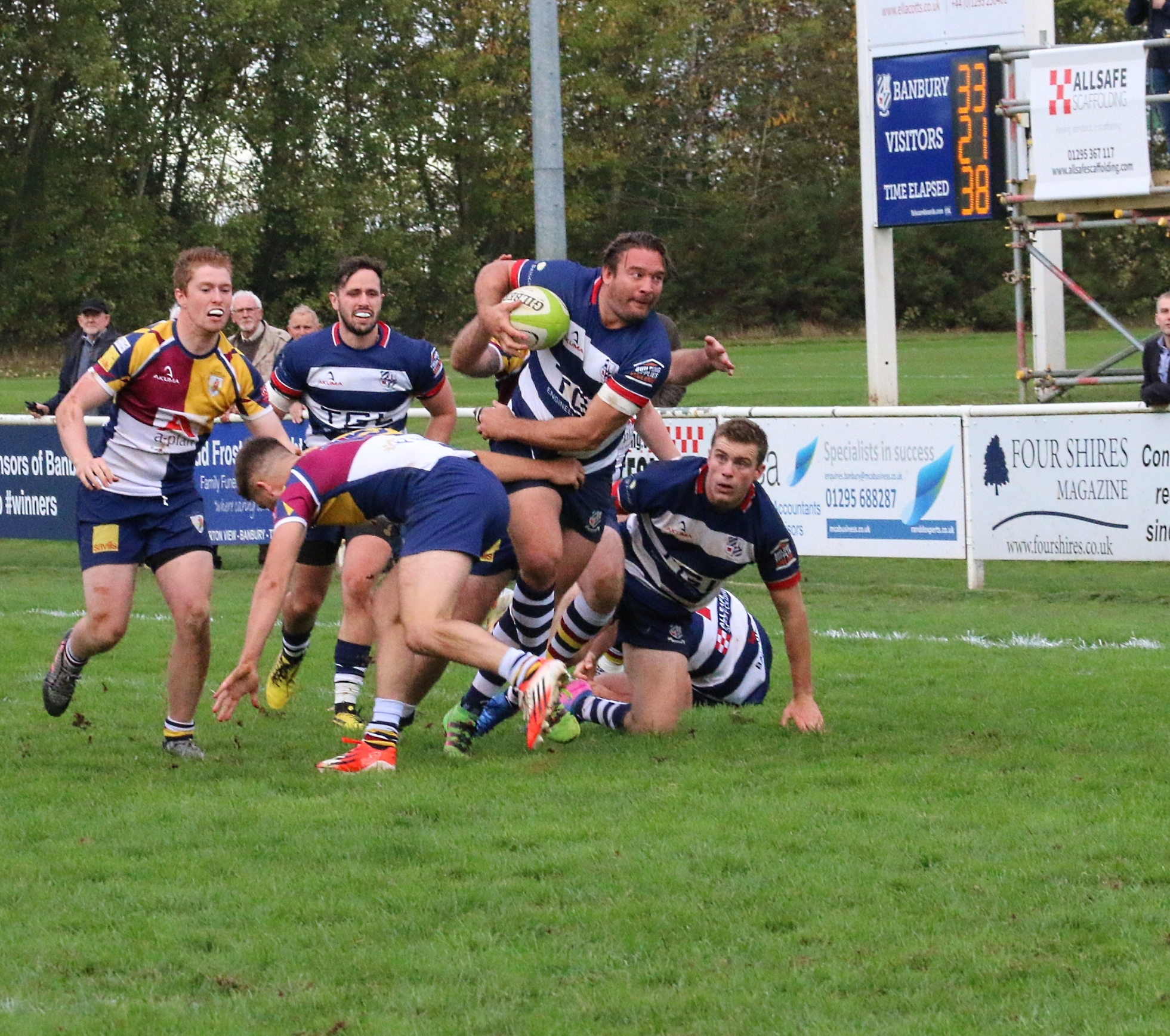 Matt Goode gets the better of Oxford Harlequins' Ed Yeates during Banbury's 40-21 victory at Bodicote Park earlier this season Picture: Simon Grieve