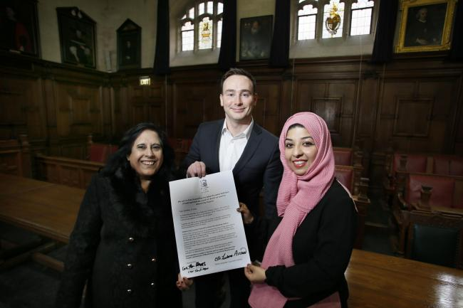 (left to right) Councillors Jamila Azad, Tom Hayes in the Town Hall celebrating the council passing a motion opposing Islamophobia. Picture by Ed Nix