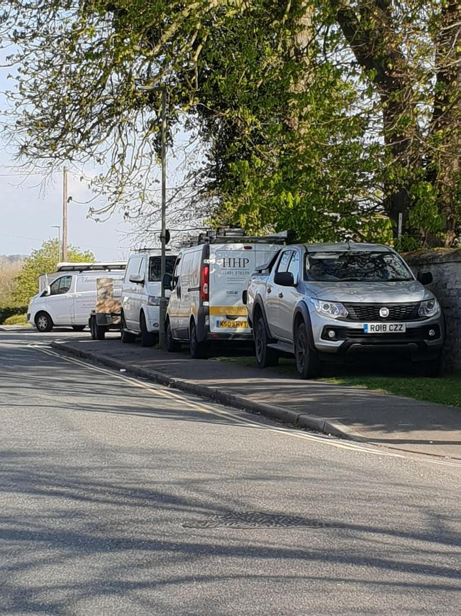 Parking along Barton Road cross over double yellow lines to park on path and grass. Obstructing view.
