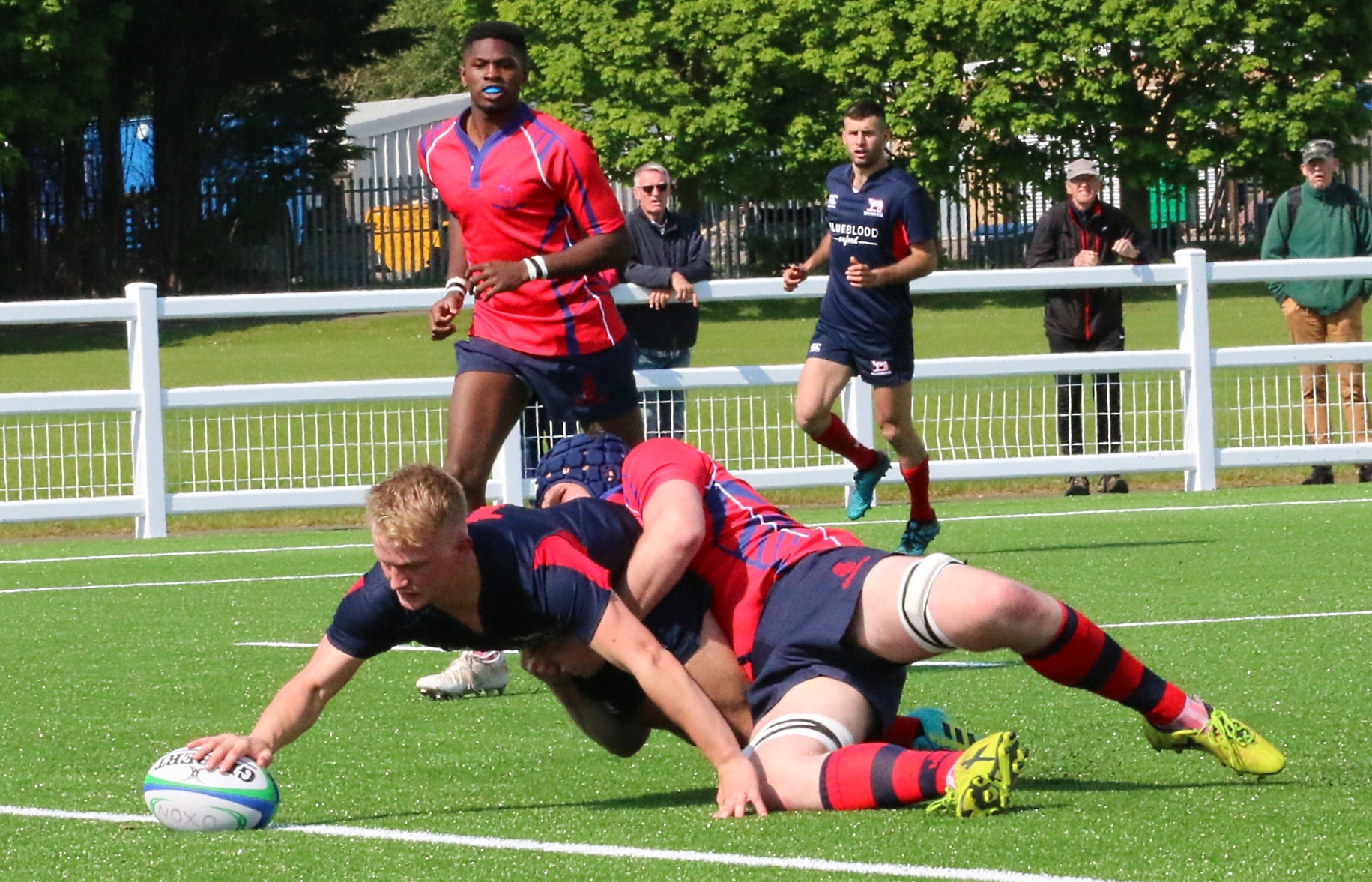 Fly-half Finn Pietersen stretches for the bonus point to put Oxfordshire 24-3 in front against North Midlands Picture: Simon Grieve