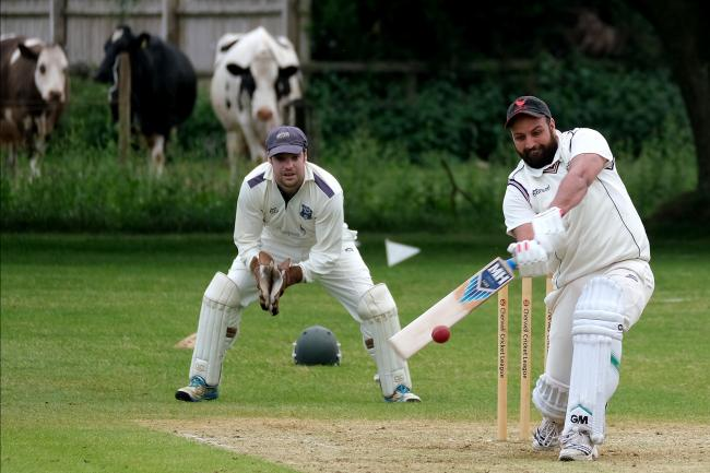 Oxford & Bletchingdon Nondescripts' batsman Wasim Mohammed hits out – with some interested onlookers paying close attention – during his side's 70-run defeat at the hands of Sandford St Martin in Division 3 of the Cherwell Leag