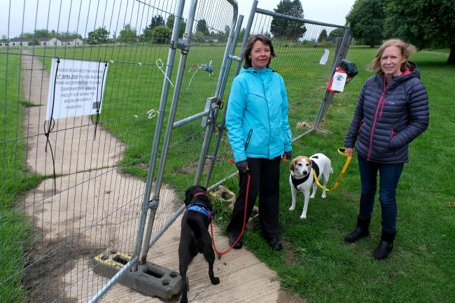 Jacqui Venvell with Willow and Linda Robertson with Tilly in Upper Heyford have had their dog walking routines at Heyford Park disrupted due to developers closing off the large open area for construction. Pic by Ric Mellis.